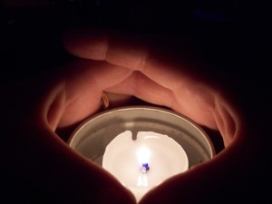 Hands and Candle